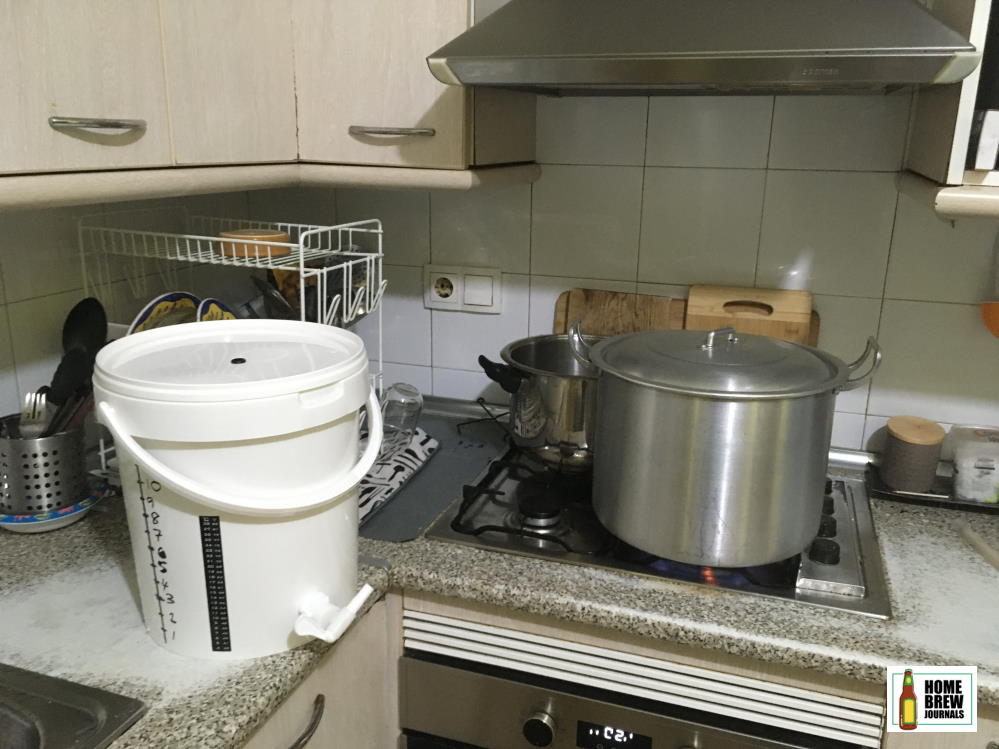 Stovetop craft beer brewing setup, stock pot brew kettle and plastic fermenting bucket